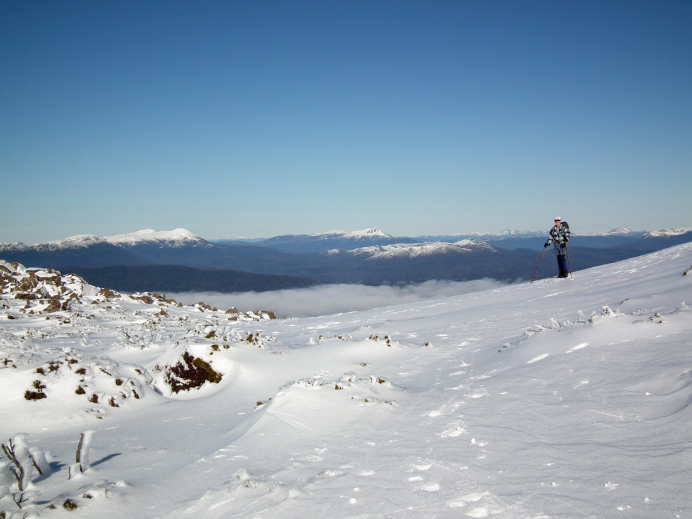 image of Cross country skiing at Mt Mawson. South West peaks in the background.