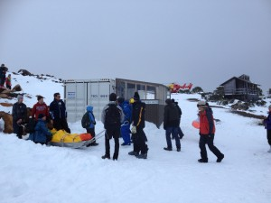 Patient on the Ski Patrol rescue sledge outside the temporary PWS Public Shelter