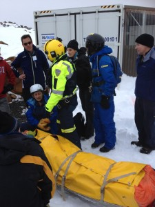 Mt Mawson Ski Patrollers and Helicopter paramedic with patient