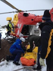 Ski Patroller Liz Koolhof attends patient prior to helicopter evacuation