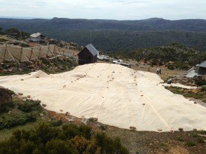 The Mt Mawson ski slope with shadecloth protection installed to aid revegetation.
