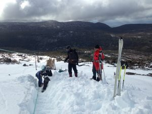 STSA Volunteers unbury the rope at the top of Mawson tow
