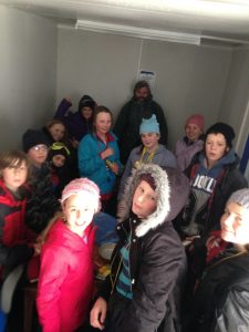 Standing room only in the Mt Mawson temporary day shelter as children shelter from the rain.