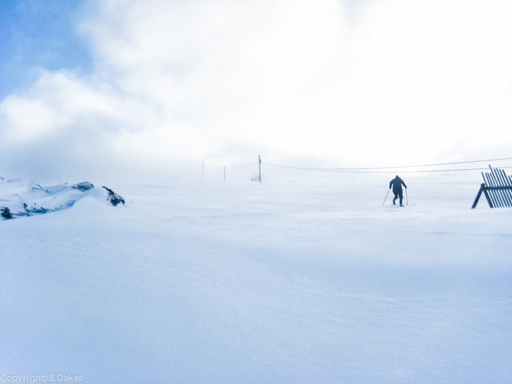 image of a Volunteer Tow Manager skinning up the Mawson run early one morning to set up the tow for the days operation.